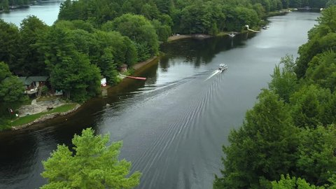 Aerial view of seadoo riding down Muskoka river in cottage country