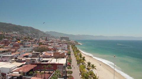 Flying over Puerto Vallarta seaside promenade, a 12 mile long walking esplanade in Puerto Vallarta, Mexico.