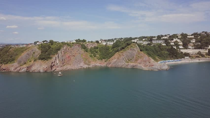 Aerial view of dramatic cliffs at western end of Meadfoot beach in Torquay, Devon county, England.