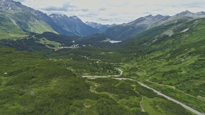 Aerial view of pass San Bernadino in the Swiss Alps   Shutterstock HD Video #1016653789