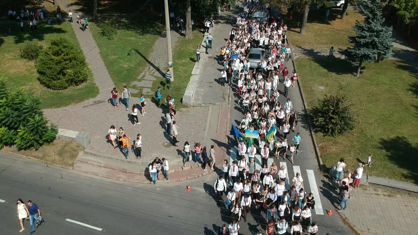 POLTAVA, UKRAINE - SEPTEMBER 29, 2018: People celebrating national embroidered shirt day on the street. Drone footage.  #1016727709