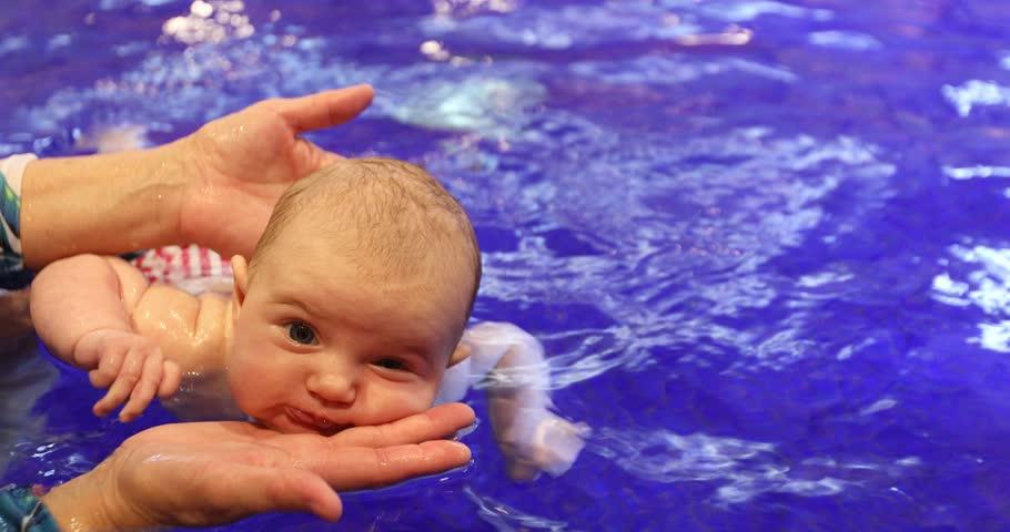 Newborn girl swimming pool whith coach close-up | Shutterstock HD Video #1016735239