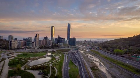 Santiago of Chile, view of the bicentennial park and some of its emblematic buildings in a timelapse hyperlapse shortly after sunset