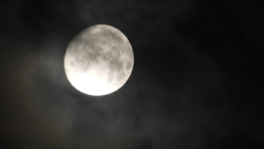 4k Moon in cloudy night sky close up video | Shutterstock HD Video #1016763529