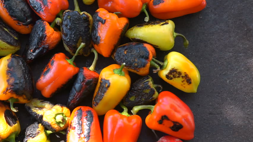 Red and yellow sweet pepper cooking on the grill | Shutterstock HD Video #1016804479