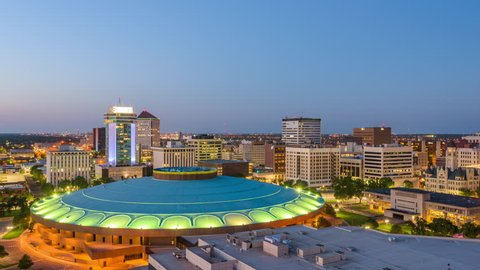 Wichita, Kansas, USA downtown skyline from dusk to night.