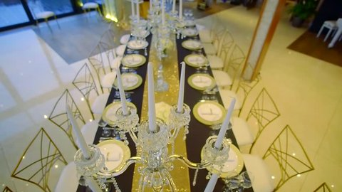 Shot from above of a beautiful wedding table, luxury service, silverware.