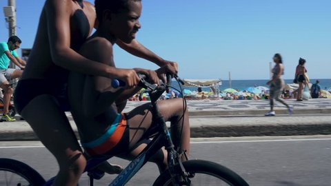 Rio de janeiro, Brazil. 09/23/2018. Kids playing in Ipanema beach on sunday. Ride bike for fun