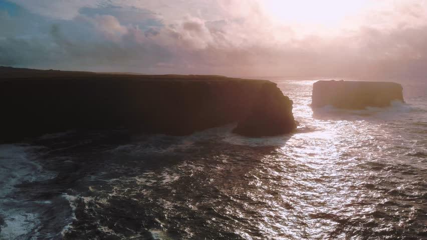 Flight over the cliffs of Kilkee at sunset – wonderful evening view   Shutterstock HD Video #1016874559