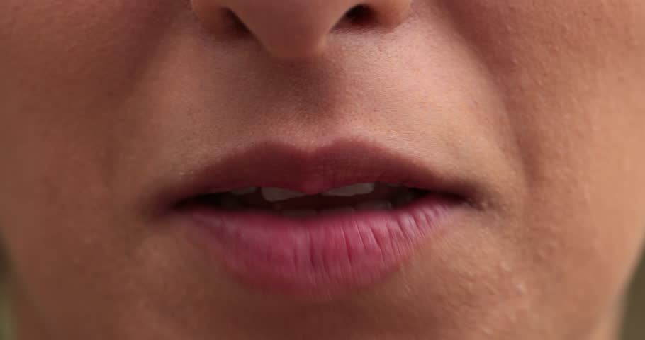 Close-up of girl lips speaking. Macro of young woman mouth speaking to viewer. | Shutterstock HD Video #1016876509