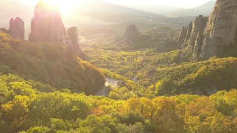 Drone Flight through the Meteora Sandstone Mountains in Greece at sunset