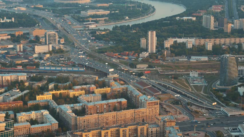 Aerial top view of Moscow city panorama at sunset, river and bridges, roads and buildings in evening myst, toned #1016897509