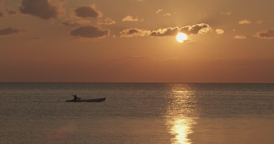 Kayaker Silhouette At Sunset | Shutterstock HD Video #1016968669