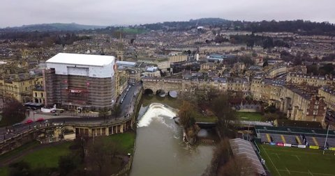 River Avon aerial shot with Pulteney bridge and the city of Bath's skyline