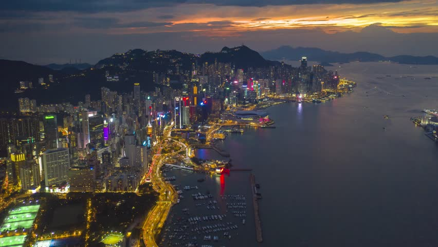 4k hyperlapse aerial scene of Hong Kong city with Victoria bay scene in sunset