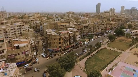A wide angle aerial shot of old buildings, busy roads and fast life of  karachi