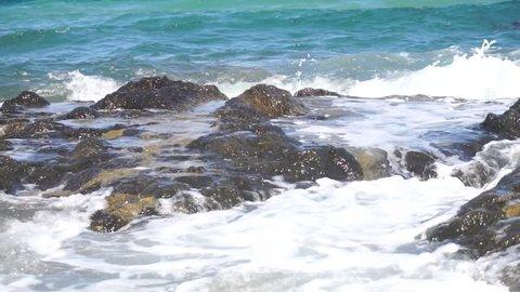 Wild rocky beach with sea waves