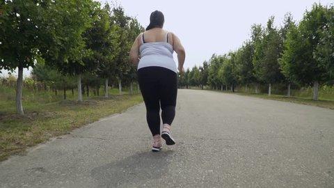 Fat girl runs along the road