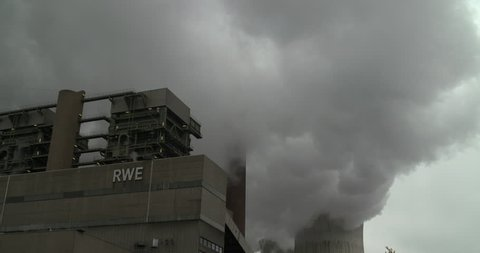 Neurath, North Rhine-Westphalia / Germany - September 28 2018: RWE power plant working on lignite producing electricity and huge gray clouds of steam