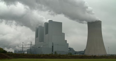Neurath, North Rhine-Westphalia / Germany - September 28 2018: RWE power plant working on lignite producing electricity and huge clouds of steam