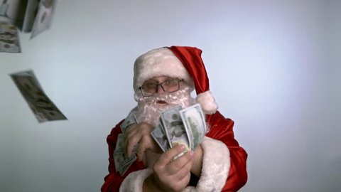 Santa Claus dancing on a white background with money in his hands.