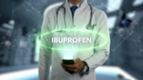 IBUPROFEN - Male Doctor With Mobile Phone Opens and Touches Hologram Treatment Word