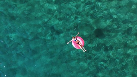 Young woman relaxing on the sea surface: Enjoy vacations