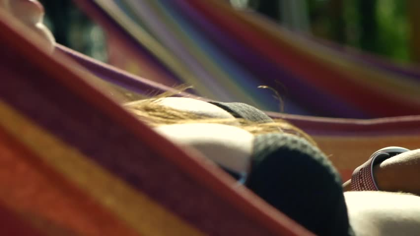 Girl with Attractive Big Breasts Smiling and Swinging on Hammock; Hot Female with Big Boobs Swinging on Hammock