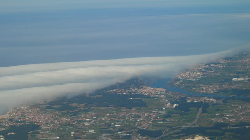 High altitude Aerial shot from plane over Braga district in Portugal showing cities of Esposende, Apulia and Fao and the Cavado river