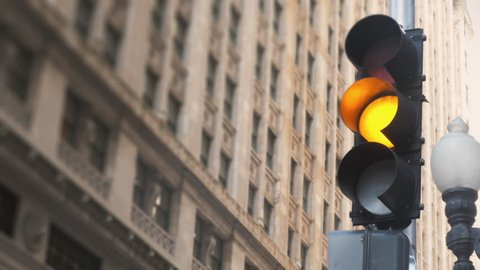 Chicago traffic light turns from green to red at downtown financial district intersection