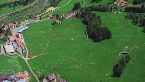 AERIAL Green fields and village / Val Di Fiemme, Trentino, South Tyrol, Italy