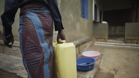 African woman with water container