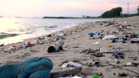 Environmental pollution on the beach near Industrial Estate, Rayong, Thailand. Spilled garbage on the beach of the big city. Environmental pollution. Ecological problem.