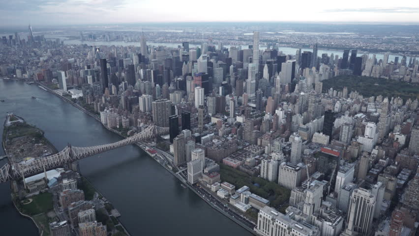 New York City Circa-2015, wide angle aerial view of the Manhattan skyline, flying toward the Upper East Side from Roosevelt Island and the Queensboro Bridge