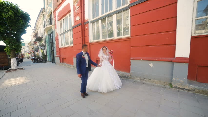 Beautiful couple walking in old historical town #1017552829