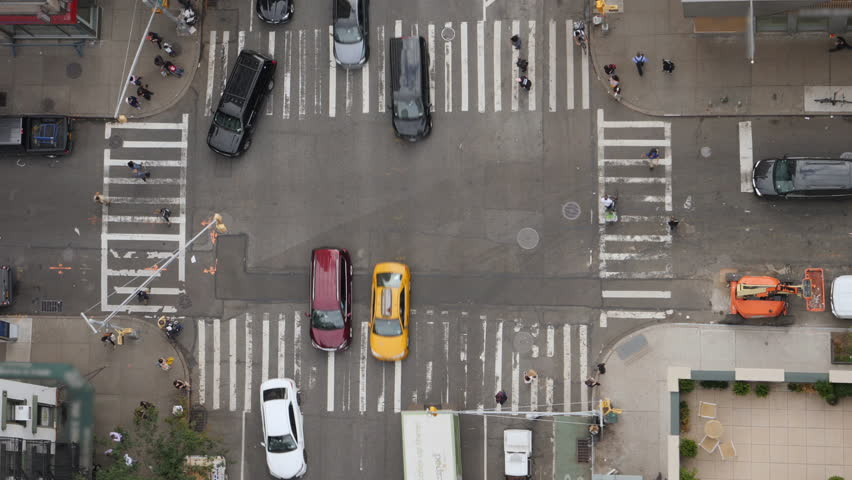 A top down bird's eye view of a typical Manhattan intersection as traffic and pedestrians travel on the streets below.  	 #1017688309
