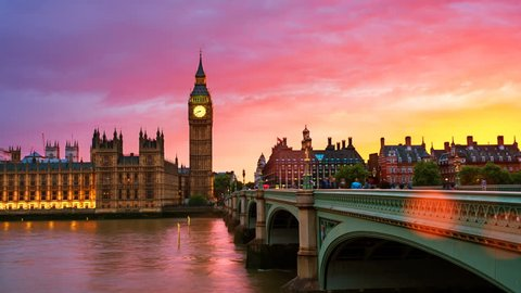 London, UK. Sunset over the city of London, UK. Colorful sky behind Westminster and Big Ben. Westminster bridge at night. Time-lapse at sunset