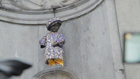 Brussels, Brussels / Belgium - 04 25 2018: Manneken Pis (Peeing Boy) is a landmark small bronze sculpture in Brussels, depicting a naked little boy urinating into a fountain's basin. Manneken Pis is t