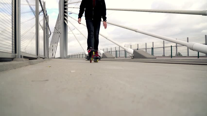 Young man in rollerblades riding in the city, super slow motion   #1017788239