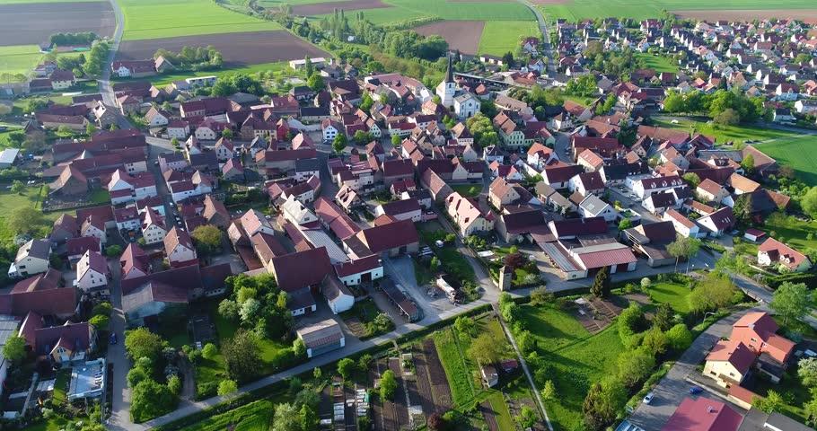 A little European city with a church in the center, European architecture, European village | Shutterstock HD Video #1017794869