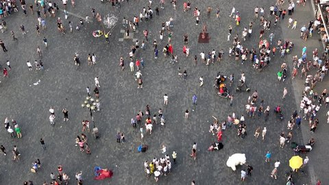 Prague, Czech Republic-13 July, 2018: 4K. Aerial view. A street full of people. Tourists in Old Town Square, a historic square in the Old Town quarter of Prague, the capital of Czech Republic-Adrian