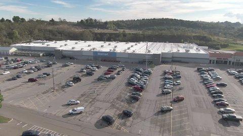 OHIO - Circa October, 2018 - A morning orbiting aerial establishing shot of a Walmart shopping plaza.