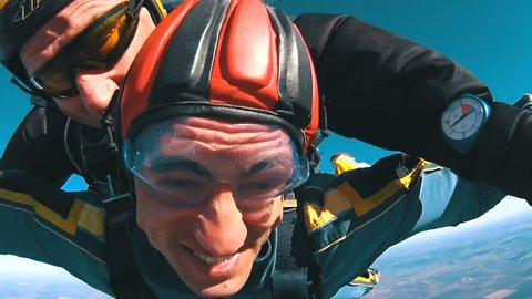 MAYSKOE, DNEPR, OKTOBER 14, 2018: Tandem Skydiving. The moment of opening the parachute. Tandem Jump. Parachutists in Long Free Fall. Real emotions parachutists in free fall. The instructor with man