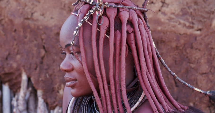 4K close-up side view of a pretty Himba girl showing head gear and neck jewellery,Namibia
