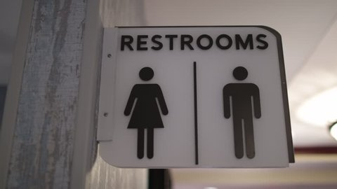 Restrooms sign white hanging icons close