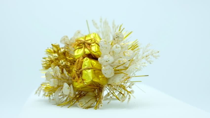 Golden Christmas bouquet of flowers with gifts on white background. Footage ready for loop. | Shutterstock HD Video #1018159429