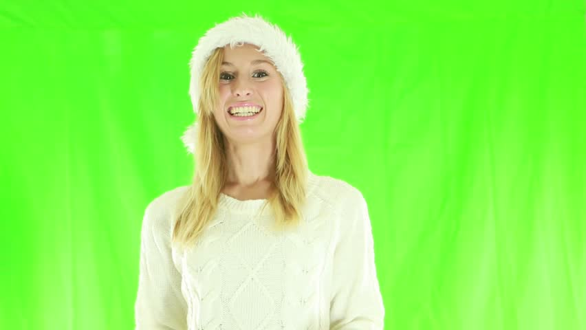 Joyful woman with Christmas hat. arms raised on green screen background    Shutterstock HD Video #1018173619