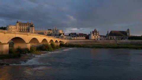 Amboise-France/Loire - October 10 2018 - The bridge and the Royale d'Amboise castle, along the Loire river at sunset - Motion view