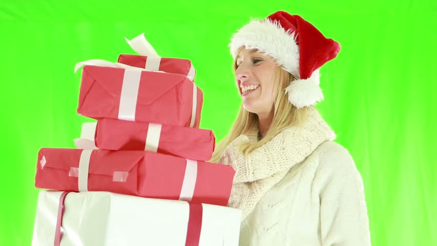 Cheerful young woman wearing Christmas hat and holding presents. Green screen   Shutterstock HD Video #1018174939