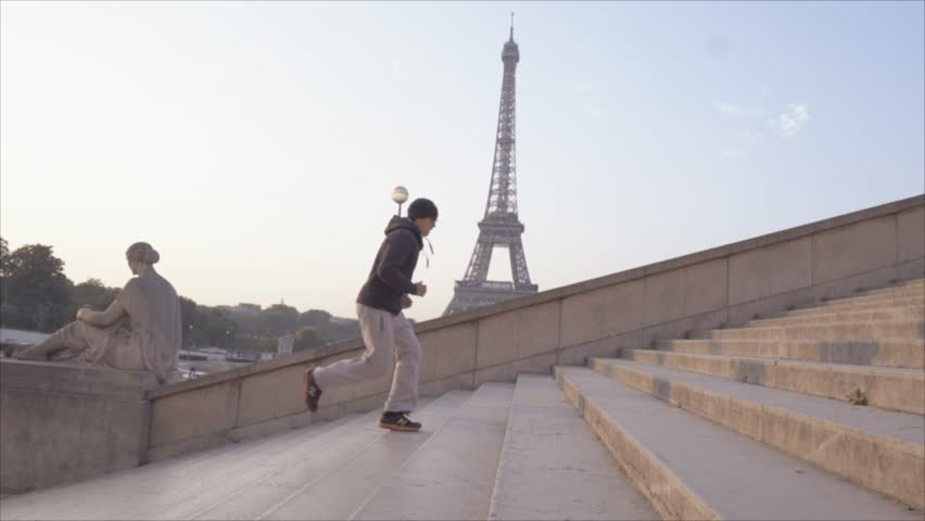 Healthy young man running up the stairs at the Eiffel Tower in Paris, France. People training sport in cities concept  | Shutterstock HD Video #1018221349